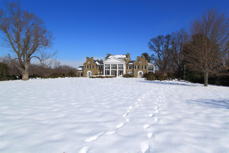 Luxurious Mansion with Snow Ground royalty free stock photo