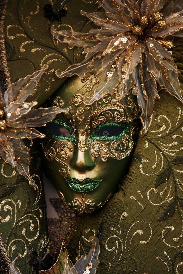 Luxurious mask. A luxurious green venetian mask stock image