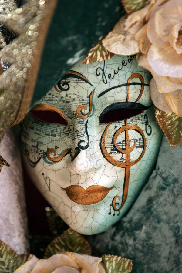 Luxurious mask. A luxurious venetian mask with gold details royalty free stock photos