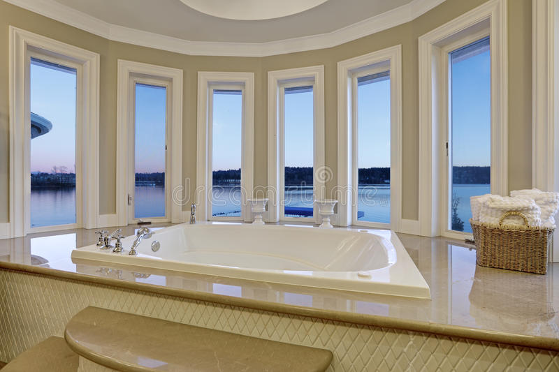 Luxurious master bath boasts jetted tub stock image