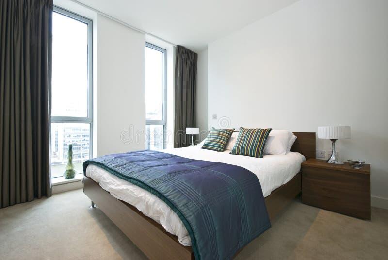 Luxurious modern bedroom stock photos