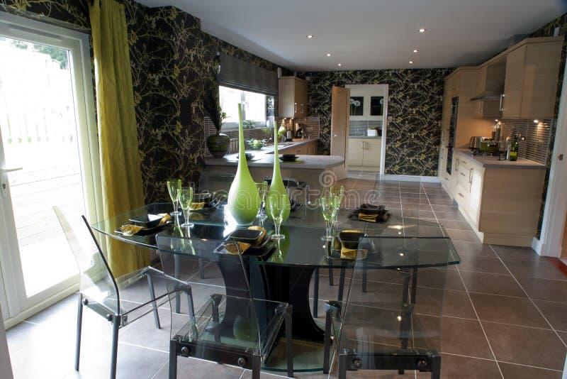 Luxurious modern kitchen. Laid glass table in spacious modern domestic kitchen stock photos