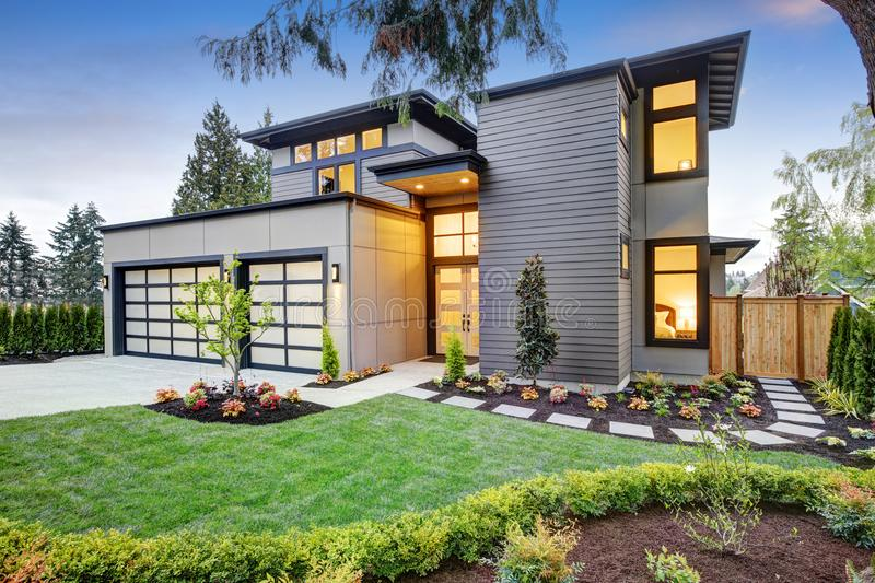 Luxurious new construction home in Bellevue, WA. Modern style home boasts two car garage spaces and well manicured front yard. Northwest, USA royalty free stock photography