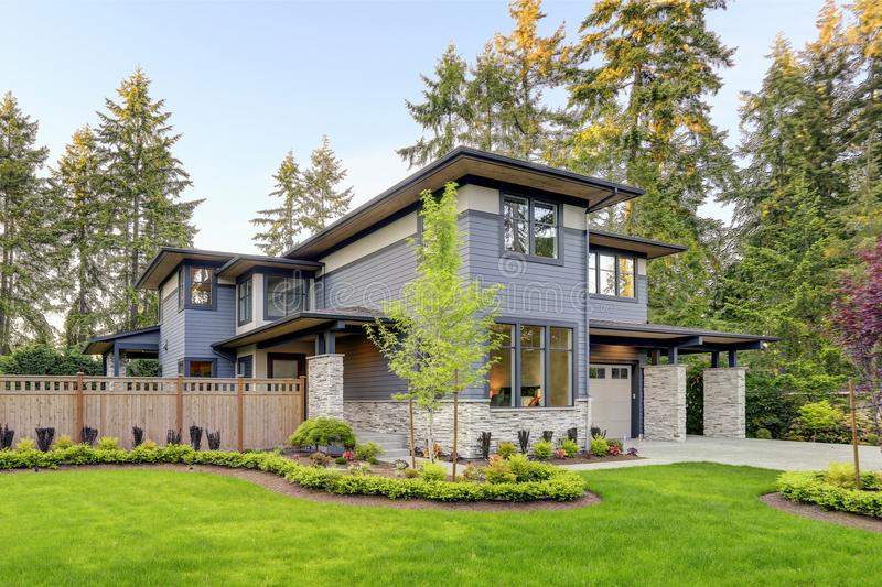 Luxurious home design with modern curb appeal in Bellevue. Luxurious new home with curb appeal. Trendy grey two-story mixed siding exterior in Bellevue with a royalty free stock photos