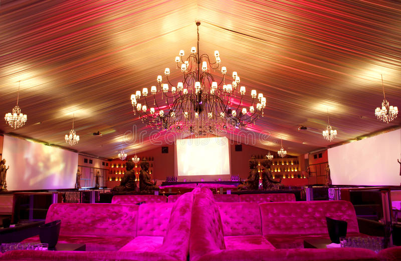 Luxurious nightclub. Interior with sofas and large chandeliers stock image