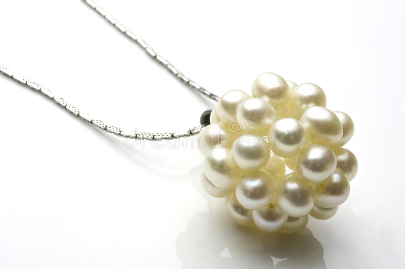 Luxurious pearl necklace. Closeup of luxurious necklace with pearls isolated on white background stock photo