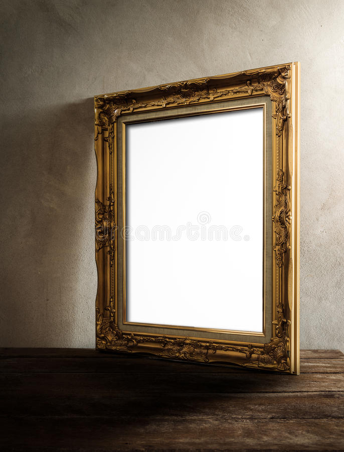 Luxurious photo frame on wooden table over grunge background stock images