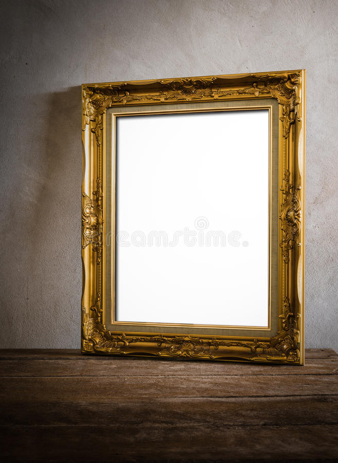 Luxurious photo frame on wooden table over grunge background stock photography
