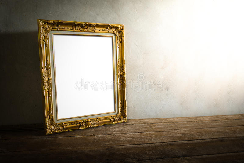 Luxurious photo frame on wooden table over grunge background royalty free stock images