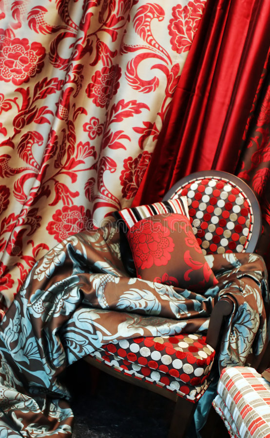 Luxurious red chair. With satin pillows and curtains - home interiors