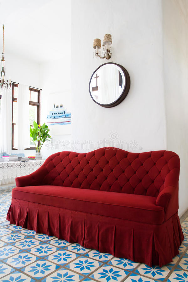 Luxurious red sofa. In living room stock images
