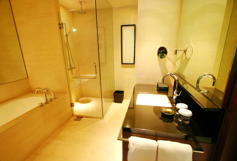Luxurious resort bathroom. An image of a modern upscale bathroom interior in a new luxurious resort hotel and spa. Fitted with separate shower area with two stock image
