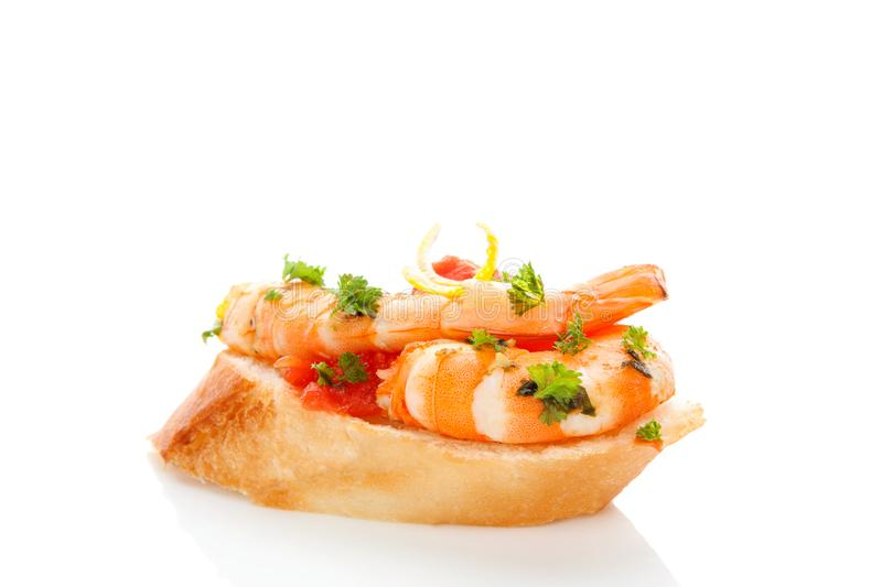 Luxurious seafood canape. Delicious Shrimp Sandwich with parsley on white background. Seafood eating concept. Seafood canape stock images