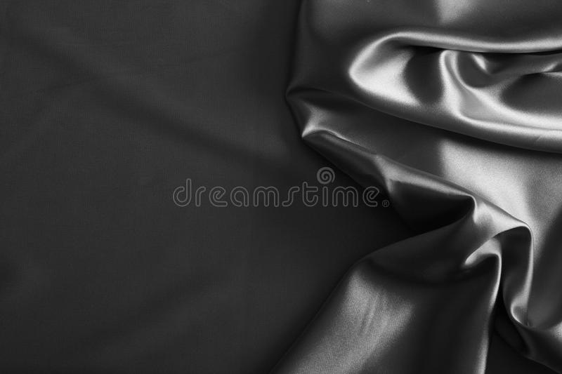 Luxurious silver satin/silk. Folded fabric, useful for backgrounds royalty free stock photos