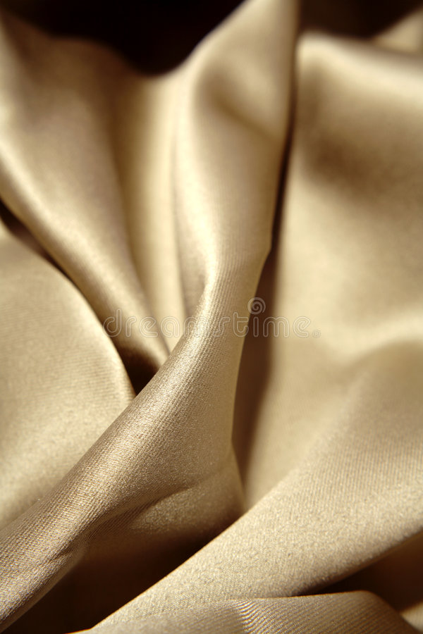 Luxurious soft gold fabric royalty free stock photos