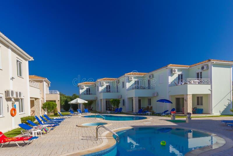 Luxurious villa with pool stock photos