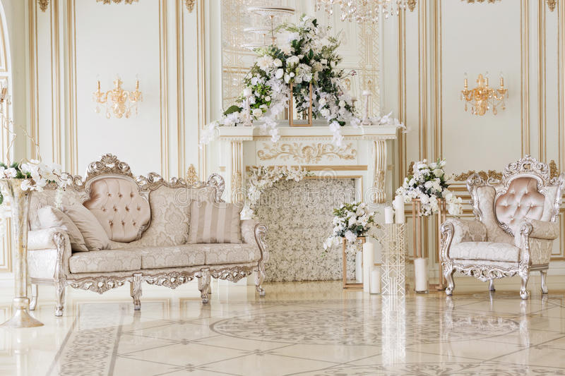 Luxurious vintage interior with fireplace in the aristocratic style royalty free stock photography