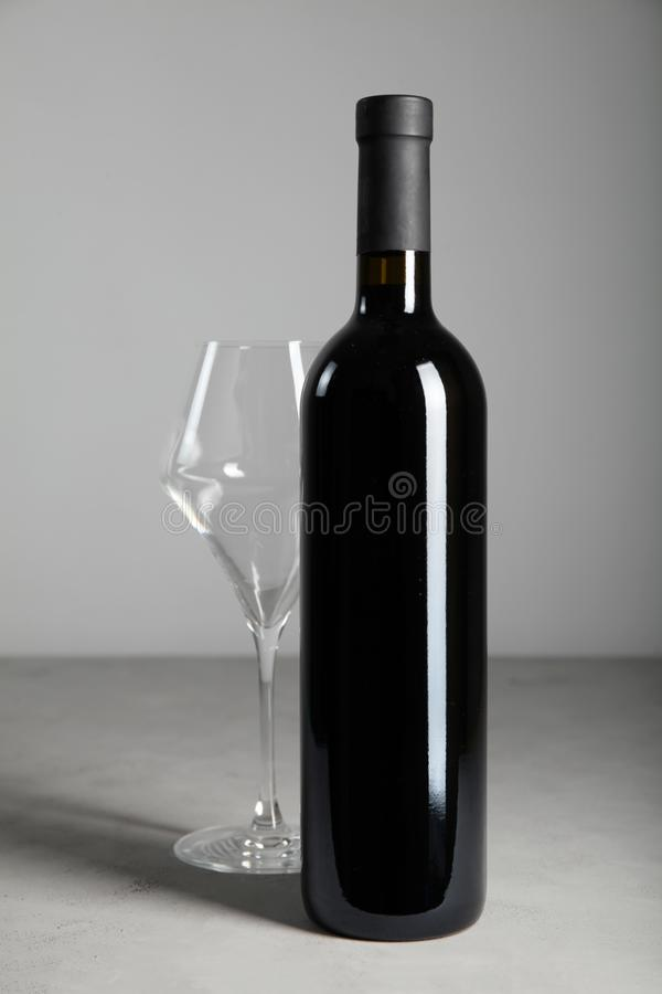 Luxurious vintage red wine in a black glass bottle.  royalty free stock image