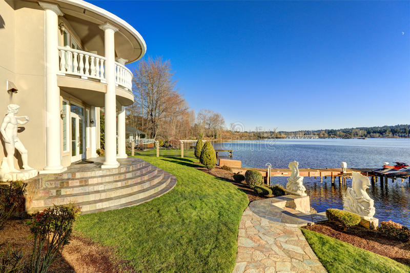Luxurious waterfront home backyard view royalty free stock photo