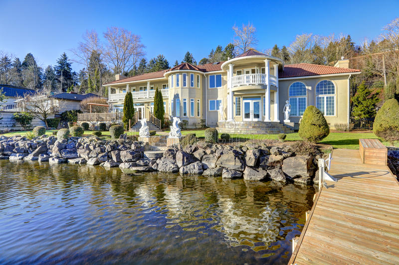 Luxurious waterfront home exterior. View from the deck. royalty free stock photos