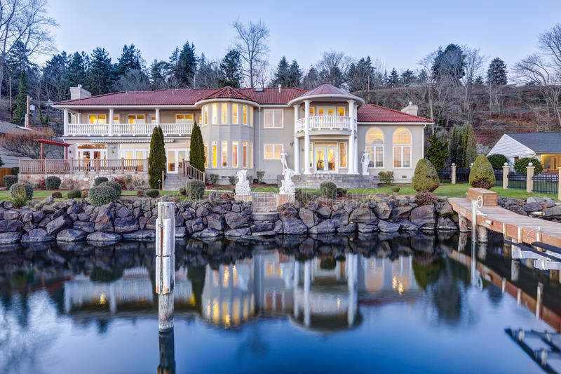 Luxurious waterfront home exterior. View from the deck. royalty free stock image