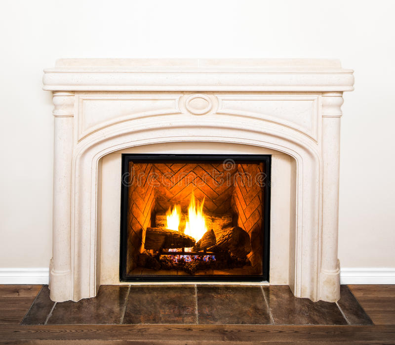 Luxurious White Marble Fireplace and empty wall. Luxurious White Marble Fireplace Detail and empty white wall stock photos