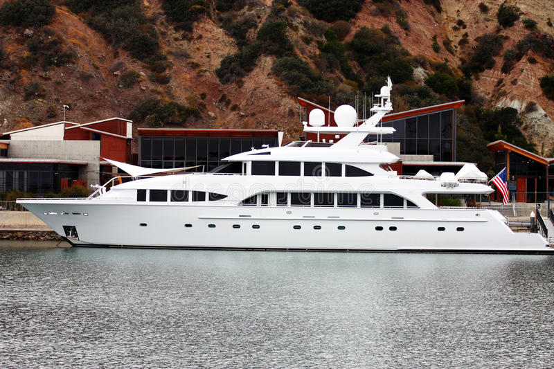 Luxurious yacht in front of research facility. Luxurious yacht moored in Dana Point harbor, California, U.S.A royalty free stock photo