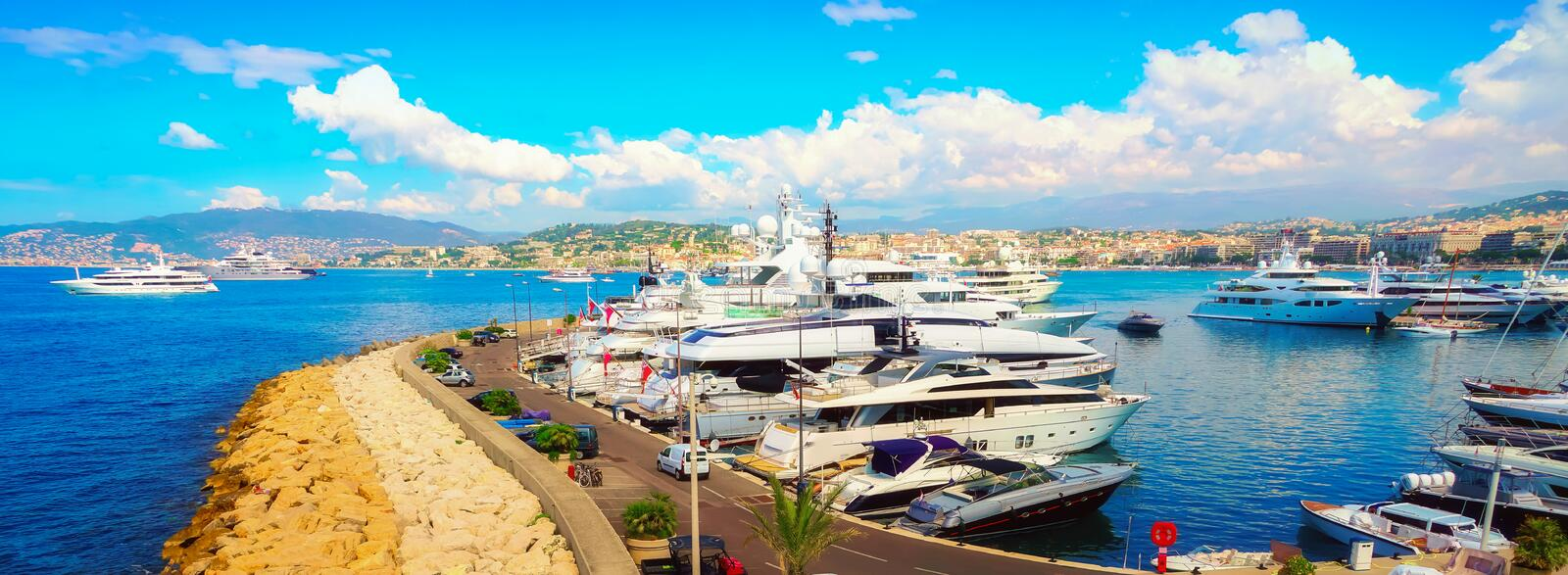 Luxurious yachts in port Pierre Canto in Cannes. A panoramic aerial image of the harbour during the film festival in one of the most famous cities in the French royalty free stock photos