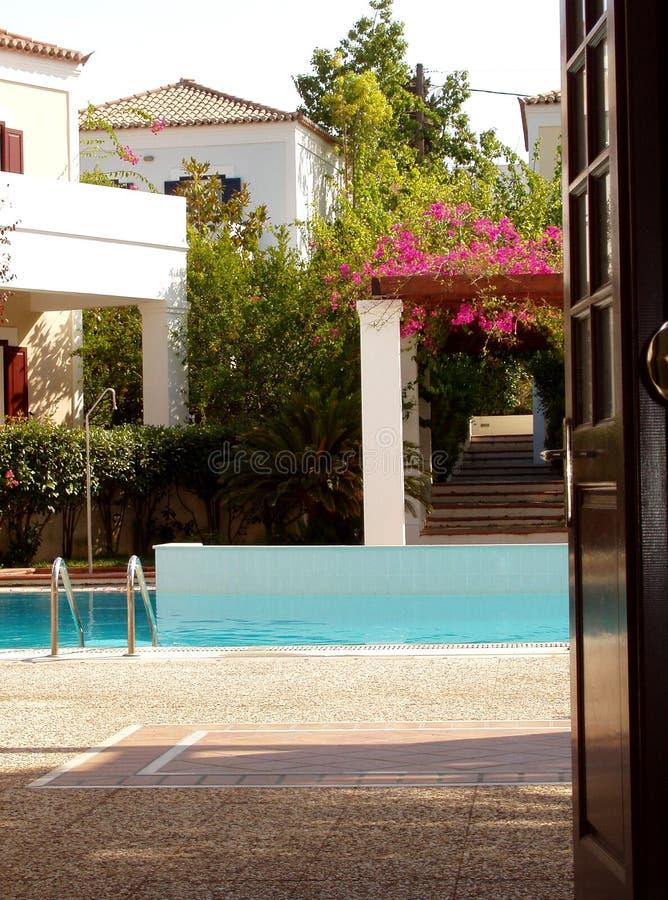 Luxury. Peek into pool area of luxurious home stock photography