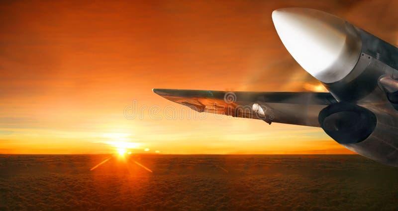 Airplane in sunrise sky. Panorama. royalty free stock image