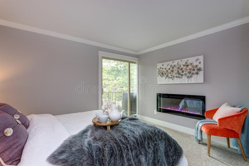 Luxury apartment bedroom with fireplace. stock photo