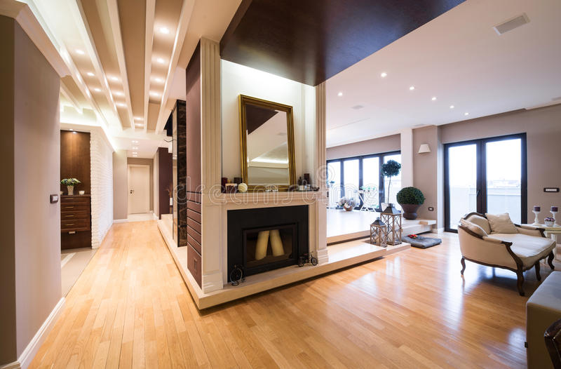 Luxury apartment interior with fireplace filed with candles.  stock images