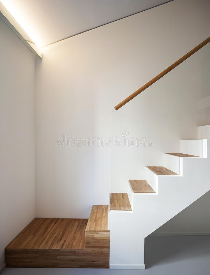 Luxury apartment, wooden staircase stock photography