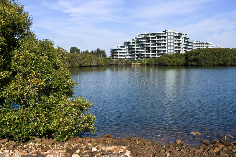 Download Luxury Apartments On The Water Stock Image - Image of lake, tall: 21905215
