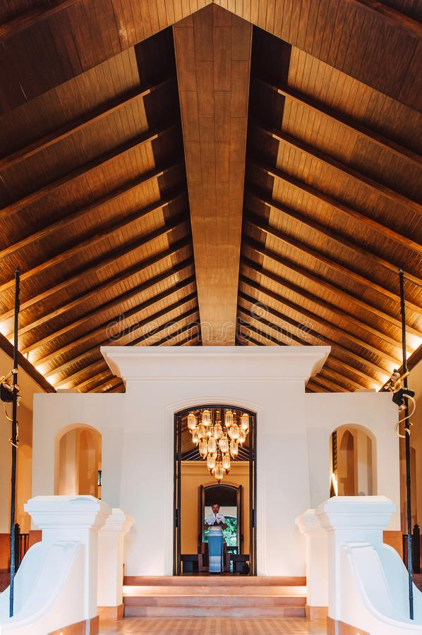 Luxury asian Thai resort entrance with high wooden ceiling, warm stock images