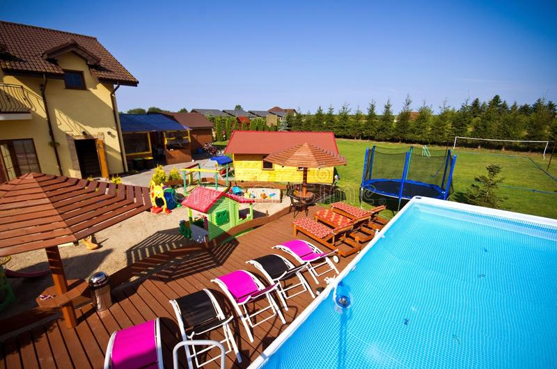 Luxury backyard with swimming pool stock photos