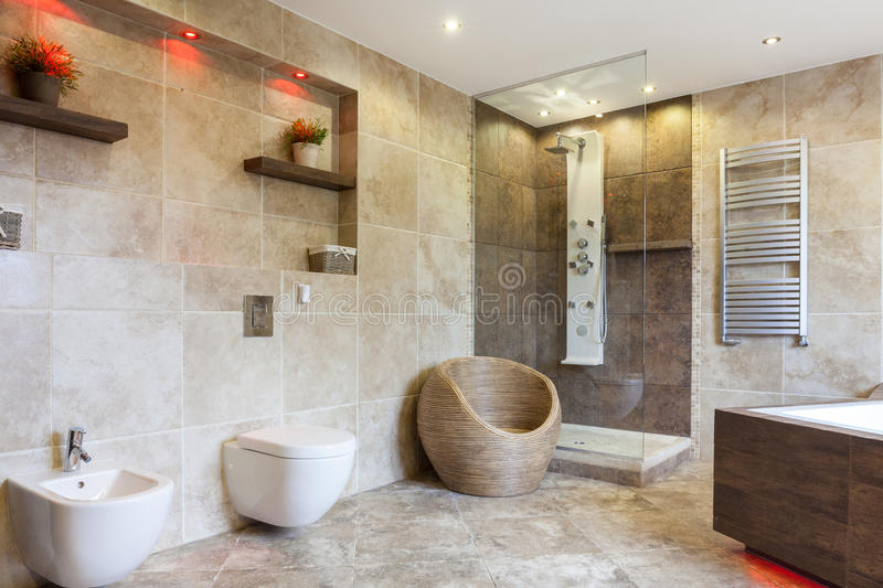 Luxury Bathroom With Beige Tiles Stock Image - Image of bright ...