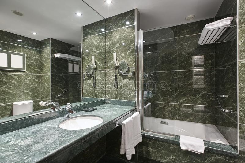 Luxury bathroom in green marble. Decoration hotel home interior stock image