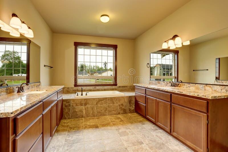 Elegant Luxury Bathroom Interior With Granite Trim And Two Vanity Cabinets.  Northwest, USA