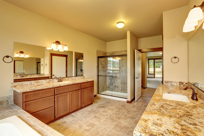 Luxury bathroom interior with granite trim and two vanity cabinets. Northwest, USA royalty free stock photography