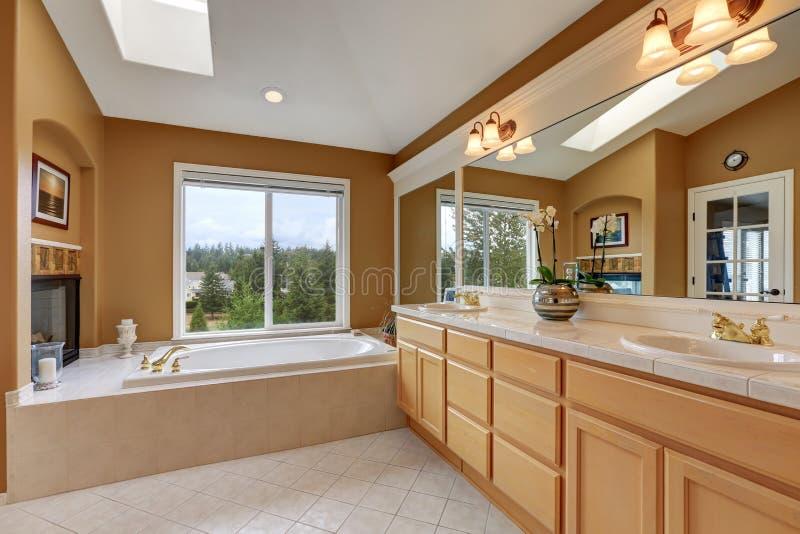 Luxury Bathroom Interior. Orange Brown Walls And Vaulted ...