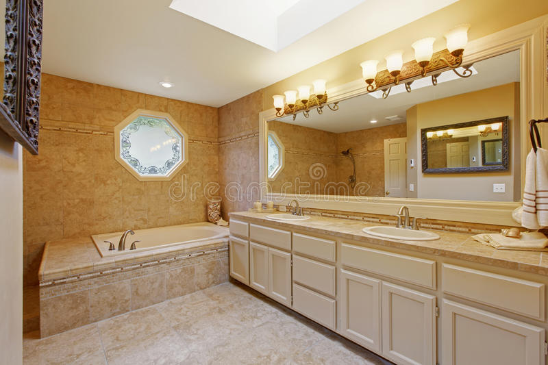 Luxury bathroom interior with tile trim. And big vanity cabinet with two sinks and large mirror stock images