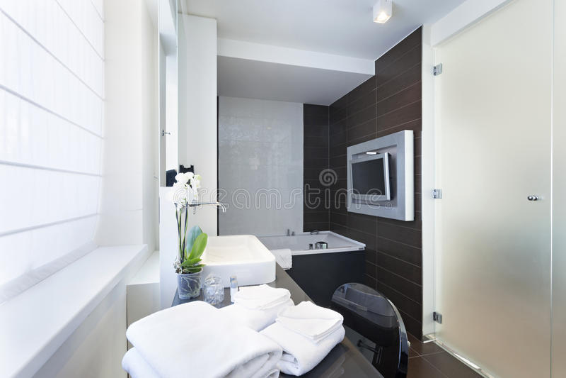 Luxury bathroom interior with wall mounted tv stock photo