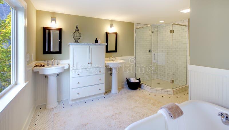 Luxury bathroom with tub glass shower double sink. Fresh modern design of bathroom stock image
