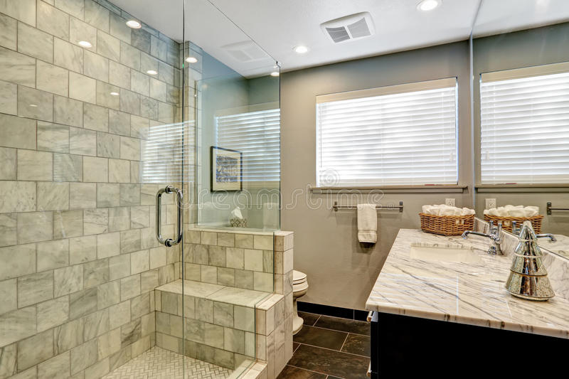 Luxury bathroom with white and grey marble and glass shower. royalty free stock photos