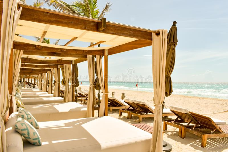 Luxury beach beds on a beach in Cancun, Mexico royalty free stock image
