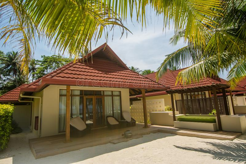 Luxury beautiful cottage on the exotic beach located at the tropical island resort. In Maldives stock photo