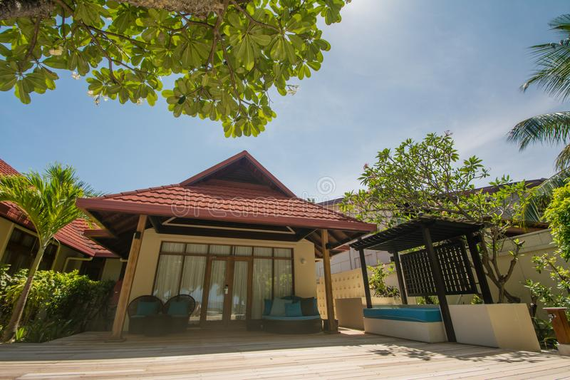 Luxury beautiful living house on the exotic beach located at the tropical island resort. In Maldives stock photo