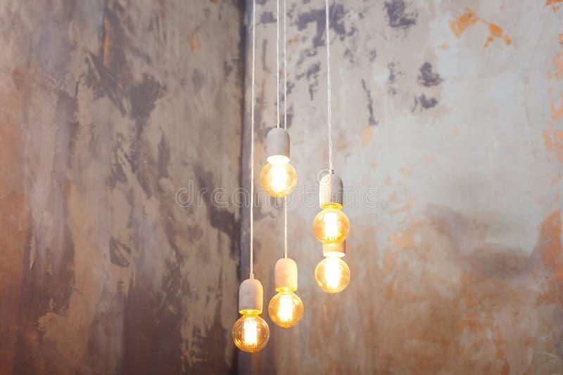 Luxury beautiful retro edison light lamp decor. light lamp electricity hanging decorate home. Set edison retro lamp on loft gray c royalty free stock photos