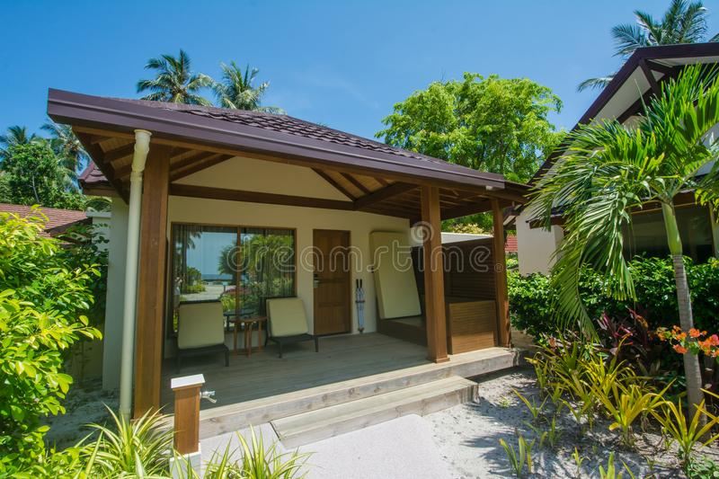 Luxury beautiful small cottage on the exotic beach located at the tropical island. In Maldives royalty free stock image